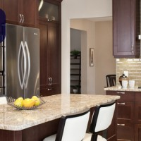 Kitchen Renovation with Granite Countertops, Millwork, Glass Backsplash, Island in Saskatoon - Impact Construction